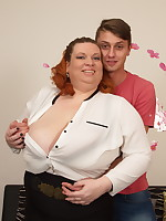 Huge breasted mature BBW playing with her toy boy