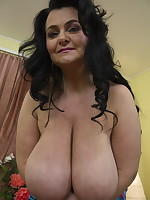 Huge breasted mature lady getting very naughty